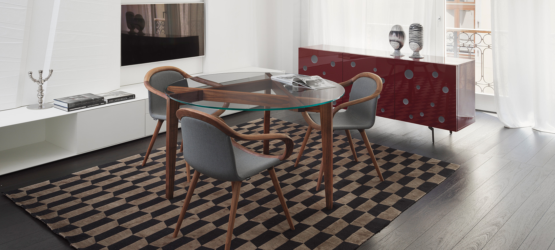 Dining room with walnut Autoreggente table and red Polka Dots sideboard